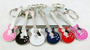 Брелоки в форме гитары! В наличии только 3 цвета: Белый,  Черный и Крас